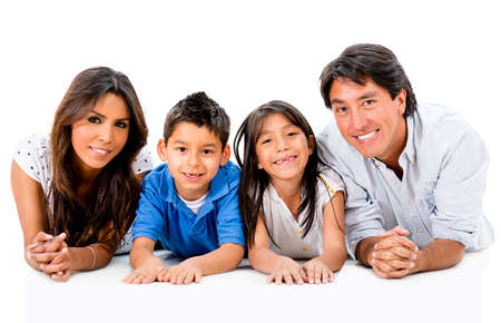 latin girls: Happy Latinamerican family lying on the floor - isolated over white Stock Photo