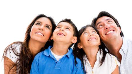 Glückliche Familie träumen und Nachschlagen - isoliert über weißem Hintergrund Lizenzfreie Bilder