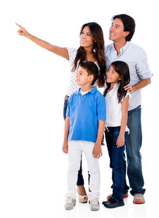 woman pointing: Happy family pointing away - isolated over a white background Stock Photo