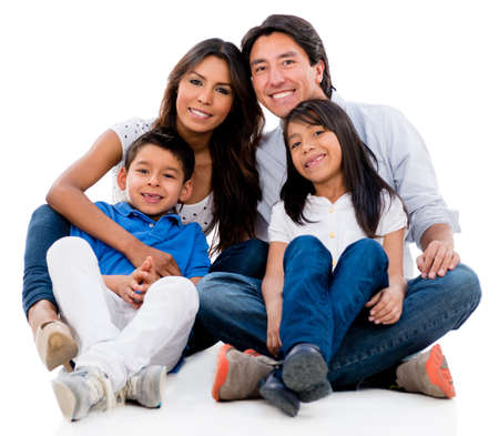 latinos: Beautiful family portrait looking happy - isolated over white background