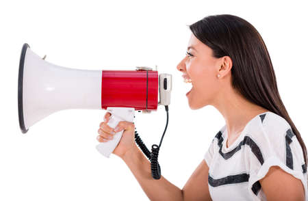 Angry woman yelling through a loudspeaker - isolated over white  photo