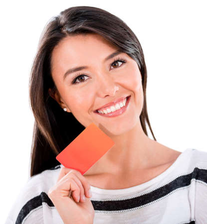 Happy woman holding a credit card - isolated over a white background photo