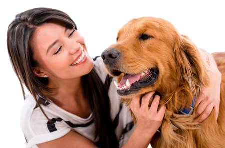 Glückliche Frau mit einem niedlichen Hund - über weißem Hintergrund Lizenzfreie Bilder
