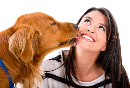 animal tongue: Cute dog kissing a woman - isolated over a white background