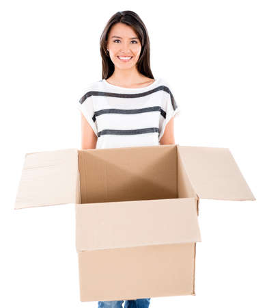 Happy woman moving and holding a box - isolated over white Stock Photo - 22617722