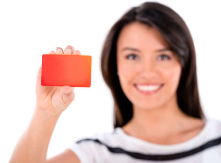 loyal: Happy woman holding a loyalty card - isolated over white  Stock Photo