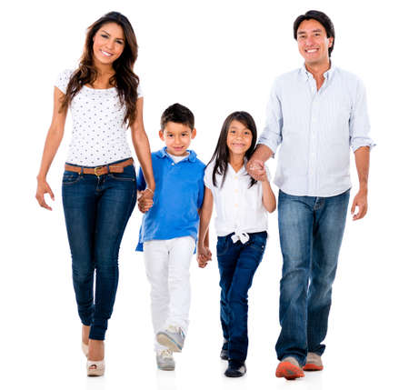Happy family holding hands and walking - isolated over white background photo