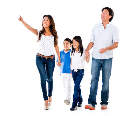 Happy family walking an pointing away - isolated over white background photo