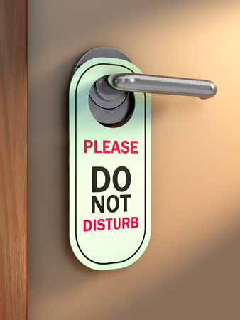Do not disturb sign hanging from a doors handle. 3D illustration. Stock Photo
