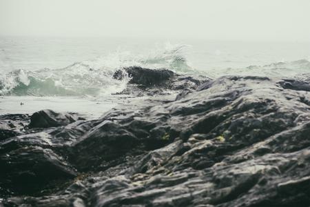 Dramatic waves on a rocky coastline.