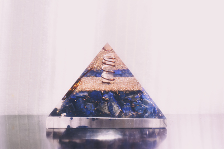 A crystal pyramid with clear quartz in the center.