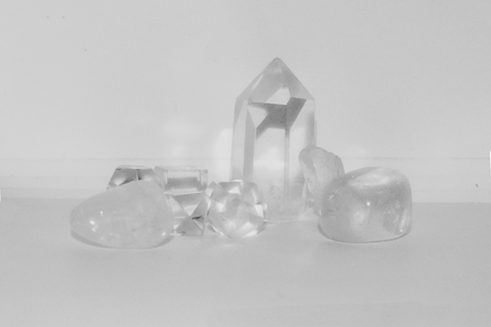 A cluster of clear quartz of different sizes and shapes.