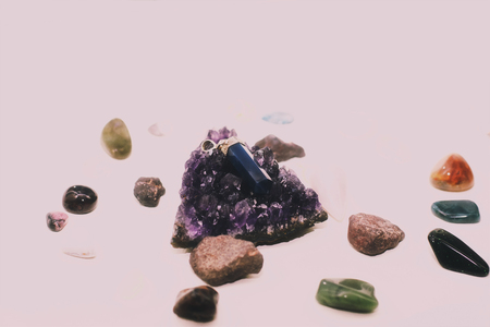 Close up of a cluster of different types of crystals and rocks.