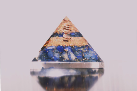 A crystal pyramid with clear quartz point inside. Stock Photo