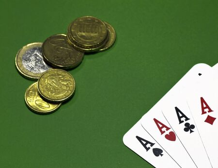 poker of aces and money on green table photo