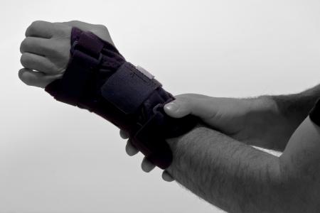 Human hand with a wrist brace Stock Photo - 23098938