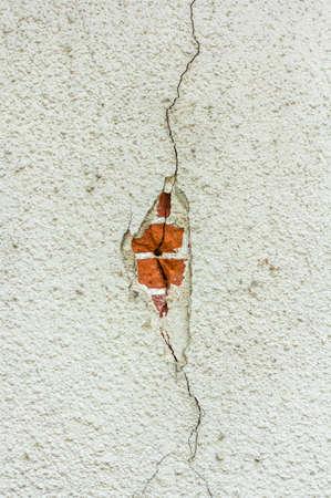 exposed: damaged wall showing exposed brick masonry Stock Photo