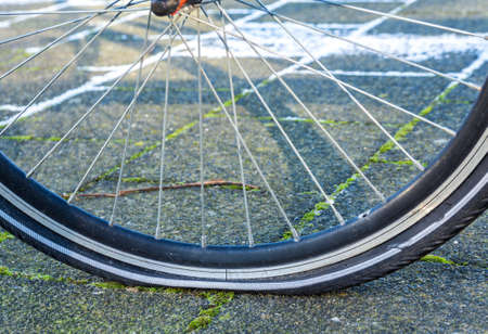 tire: bicycle with a flat tire