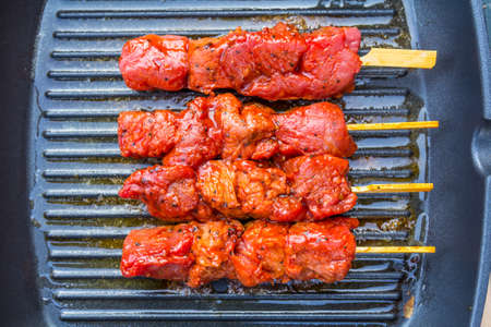 raw meat beef kebabs on a skillet Stock Photo