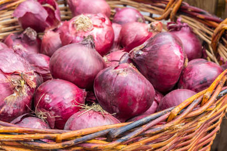 fresh red onions in a basket