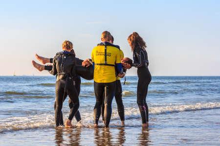 dutch girl: Kijkduin beach, the Netherlands - July  4, 2016: beach rescue training Editorial