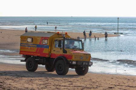 Kijkduin beach, the Netherlands - July  4, 2016: surf life saving vehicle on the beach