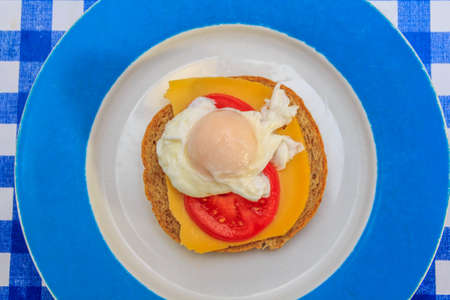 carbohydrates: Poached egg on tomato, cheese and brown bread