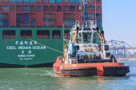 tonne: Rotterdam, the Netherlands - April 9, 2017: CSCL Indian Ocean container ship with tug boat in Rotterdam harbor