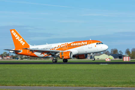 Amsterdam Schiphol Airport, the Netherlands - April 14, 2017: Easyjet aircraft landing at Amsterdam Schiphol Airport Editorial