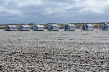 holland: Kijkduin beach, the Netherlands - April 06 2017: beach huts looking out over the sea Editorial