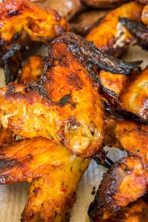 reduce risk: pan of freshly roasted chicken wings