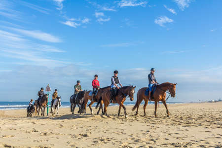 Kijkduin beach The Hague, the Netherlands - 1 October 2016: horse riders on the beach