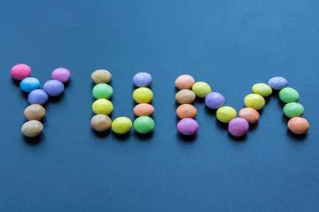 sweet sugary confenctionery in the word yum Stock Photo