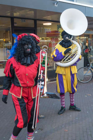 zwarte: The Hague, the Netherlands - 26 November2016: Black piet or zwarte piet celebrating arrival of Dutch Santa Clause, Sinterklaas