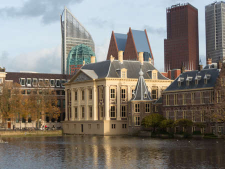 the hague: The Hague, the Netherlands - 12 October, 2017: Mauritshuis museum, historic Binnenhof buildings and modern buildings of The Hague in background Editorial