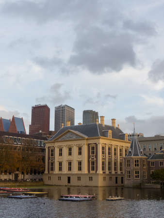 politic: The Hague, the Netherlands - 12 October, 2017: Mauritshuis museum historic Binnenhof buildings iand modern skyscrapers of The Hague in background Editorial