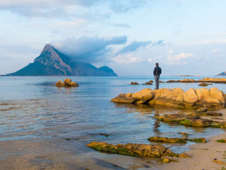 San teodoro, Sardinia Italy - May 8 2018: beautiful shallow blue water bay overlooking Isola Tavara island of Sardinia