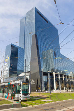 Rotterdam, the Netherlands - April 7 2018; modern tall buildings in centre of the city with RET tram in foreground Redakční