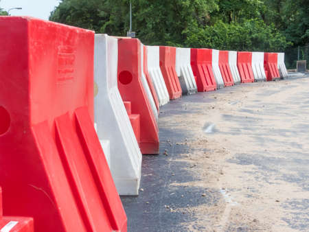 The Hague, the Netherlands - 16 June 2018: plastic barriers on newly constructed road 版權商用圖片 - 106772676