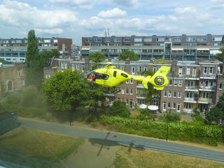 Rietland park, Amsterdam, the Netherlands -July 18 2018: emergency medical trauma helicopter lands in Amsterdam to attend victims of traffic accident