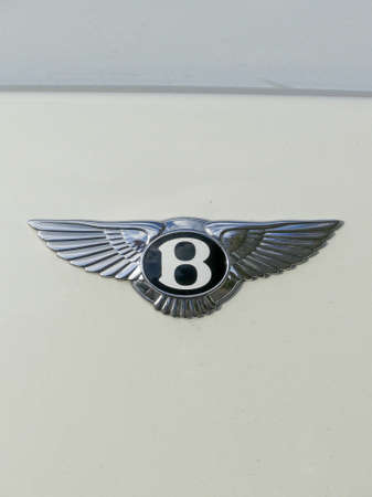 The Hague, the Netherlands - November  11 2018: Bentley winged B badge on white background Editorial