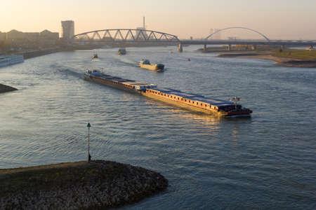 Nijmegen, the Netherlands - November 16 2018: cargo river barges passing near Nijmegen during time of low river levels Editorial