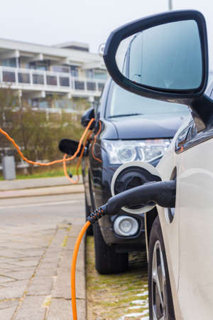 Kijkduin, The Hague, the Netherlands - 13 January 2018: hybrid electric cars charging with electric plug in power station