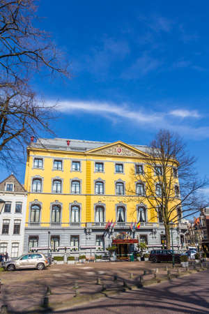 The Hague, the Netherlands - March 23, 2017: Hotel Des Indes in The Hague with fresh yellow paint on sunny blue sky day