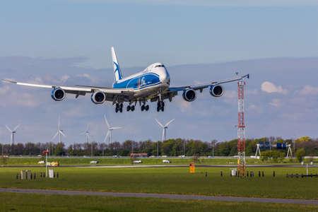 Amsterdam Schiphol Airport, the Netherlands - April 14, 2017:Air Bridge Cargo 747 aircraft landing at Amsterdam Schiphol Airport Imagens - 115967580