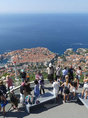 Dubrovnik, Croatia - August 4 2018: tourists looking out over panorama view of old town histoic unesco monument from viewing platform Editorial