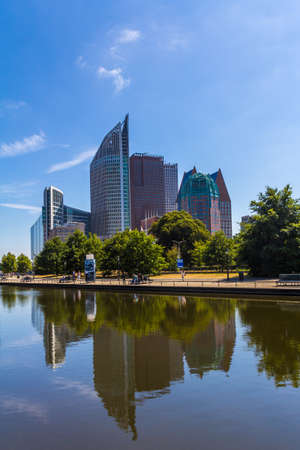 The Hague, the Netherlands - July 12, 2018: The Hague modern city skyline with lake foreground and blue sky background