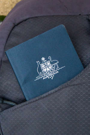 The Hague, the Netherlands - December 12 2018: Australian passport slid into bag front pocket ready for travelling