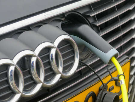 The Hague, the Netherlands - December 26 2018: Audi car recharging at plug in electric charge point closeup Editorial