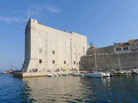Old harbour of Dubrovnik - August 6 2018: walled old harbor of the old town of Dubrovnik, Croatia